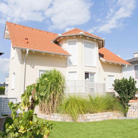Einfamilienhaus - Holzhaus und Carport